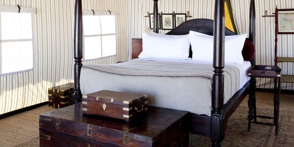Luxury bedroom at San Camp Botswana