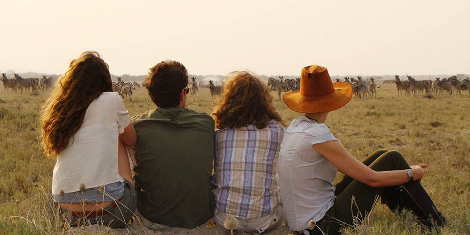 Safari group watching herd of Zebra in Botswana's Makgadikgadi Pans