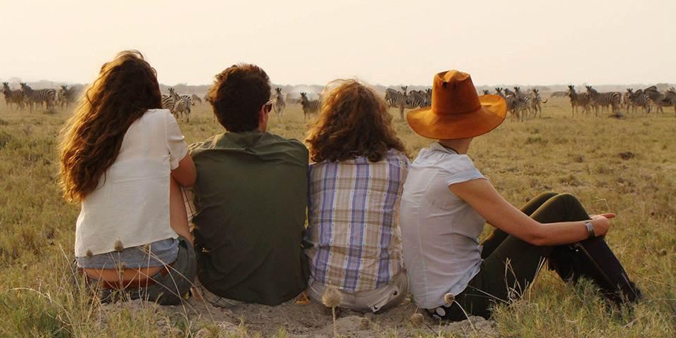 Group on safari at Jacks Camp viewing zebra