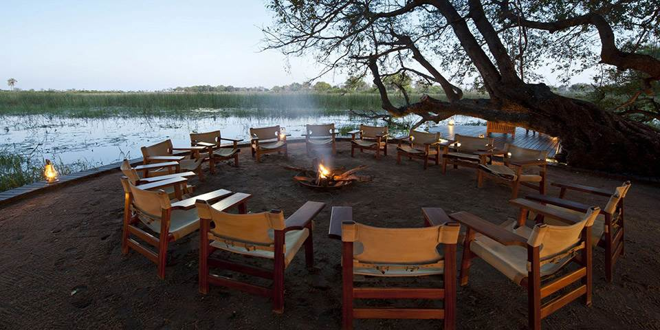 Seating around the fire on the banks of the Okavango River