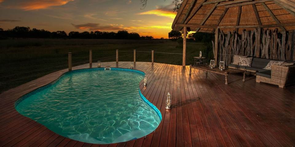 Outdoor pool & decked area at luxury Chitabe Lediba safari camp