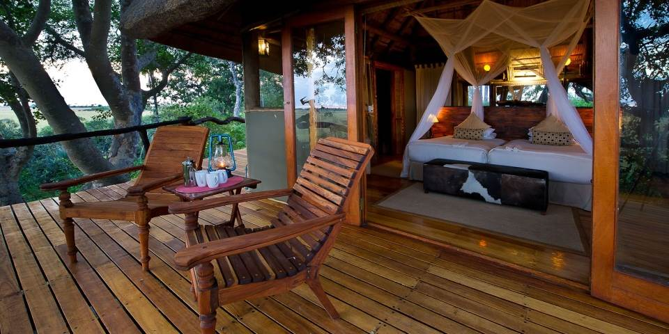 Decked seating area outside bedroom at Kwetsani safari camp
