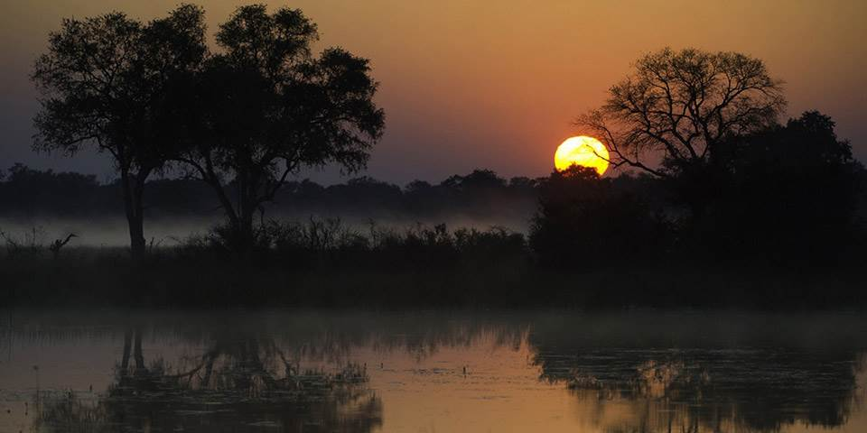 Sunset in the Okavango Delta seen from Little Vumbura safari camp