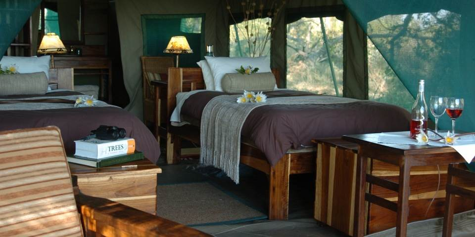 Luxury bedroom at Macatoo safari camp
